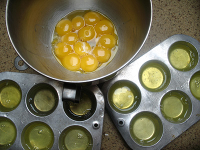 Dozen separated eggs. Yolks for custard. Whites for freezer