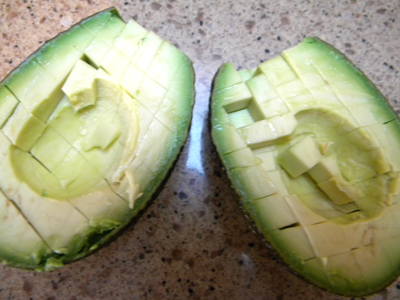 avocado diced in the shell, ready to scoop out