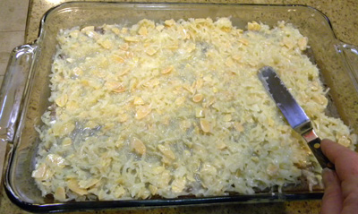 Spreading coconut-almond layer onto partially baked crust