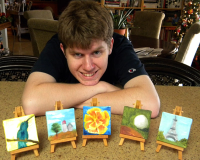 Connor with his paintings, hummingbird for me, barn for Grandpa Otter, flower for Grandma Hopkins, golf ball for Dave, and Eiffel Tower for Marissa.