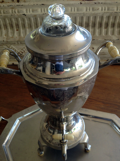 """""""Universal"""" silver-plated nickel coffee percolator urn was manufactured by Landers, Frary & Clark in the 1920s. It has ivory bakelite handles and an etched design on the body."""